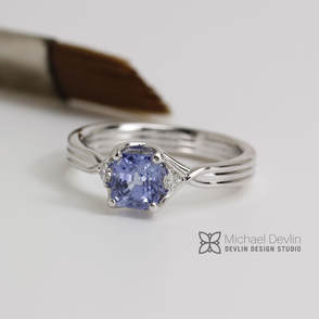 blue sapphire ring , cross over braid style 14k white gold