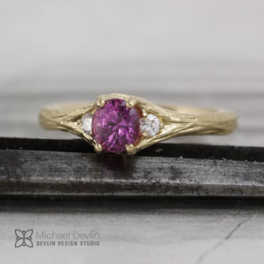 pink sapphire twig style ring with diamonds